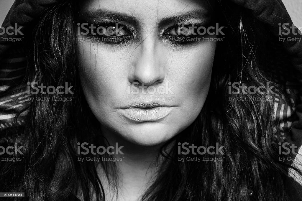 close-up of model looking into camera wearing makeup stock photo