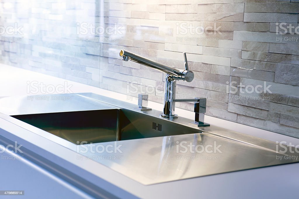 close-up of modern kitchen sink stock photo