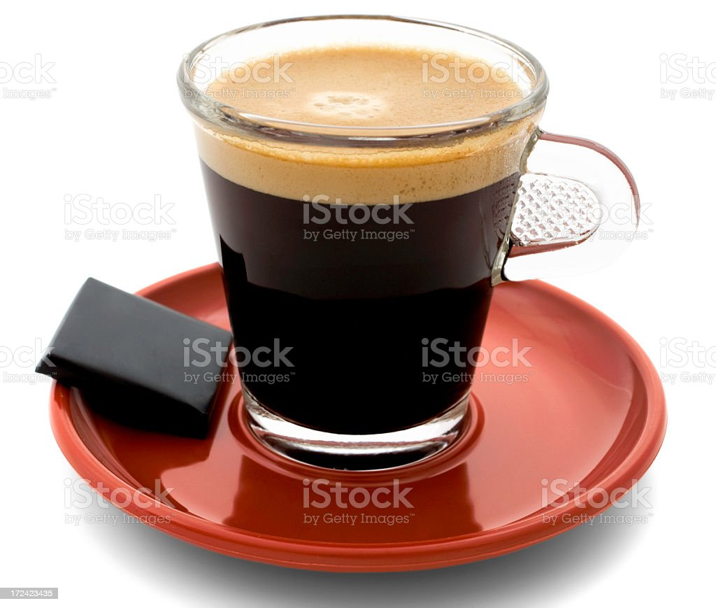 Close-up of morning coffee in a clear mug on a red saucer royalty-free stock photo