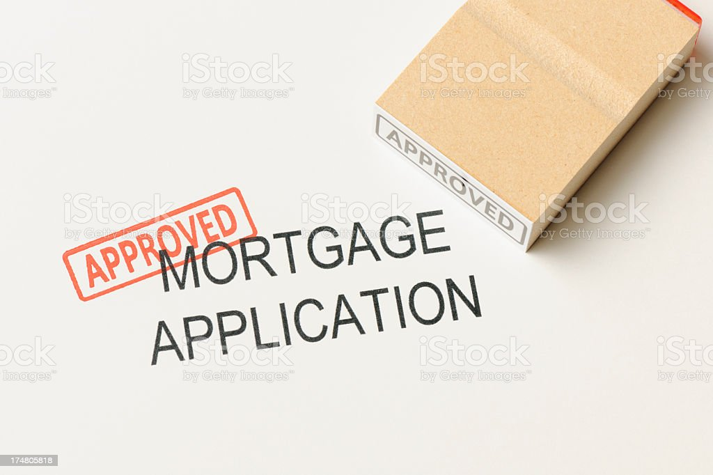Close-up of mortgage application with 'Approved ' rubber stamp royalty-free stock photo