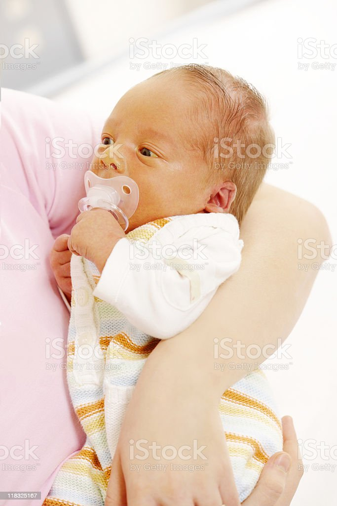 close-up of mother holding her newborn Jaundice baby at home stock photo