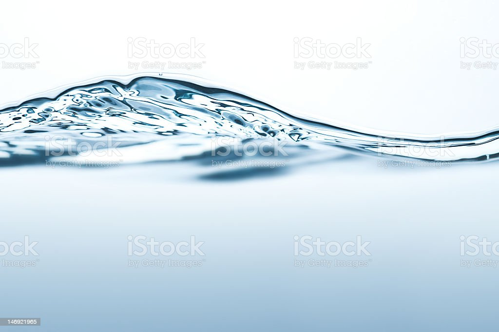 Close-up of moving water on a transparent container stock photo