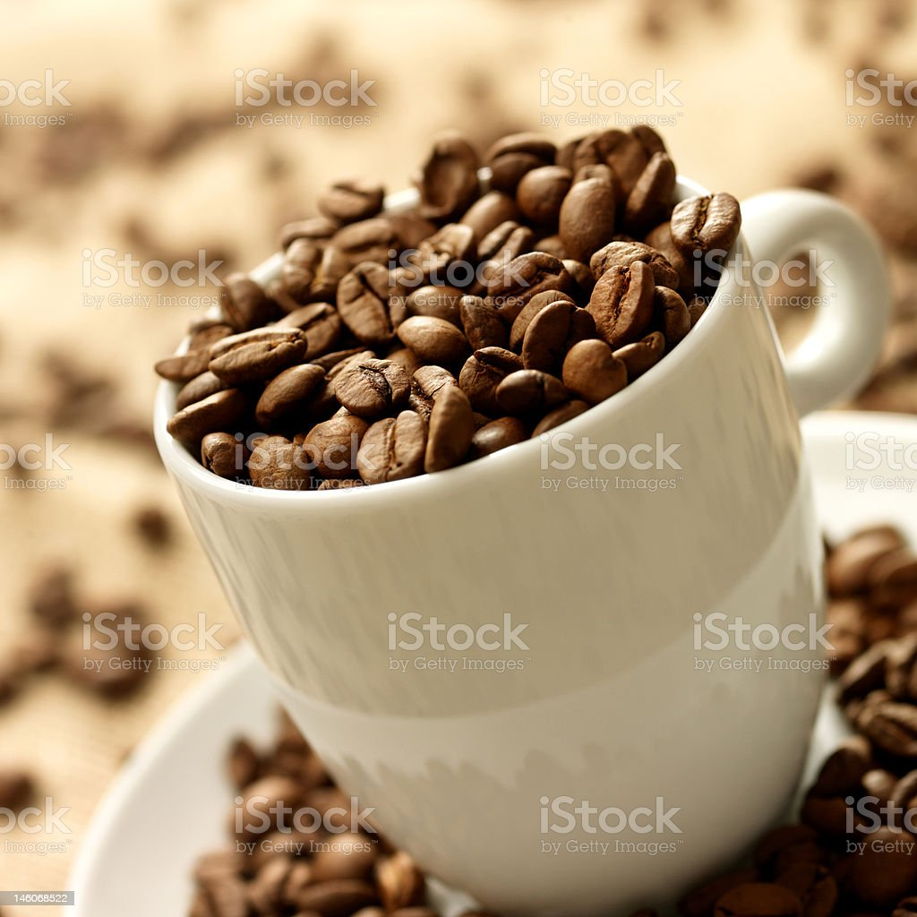 Close-up of mug full with coffee beans royalty-free stock photo