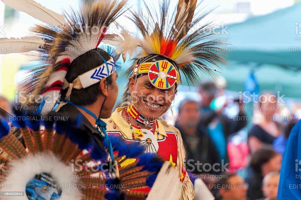 Closeup of Native Americand dressed in full Regalia stock photo