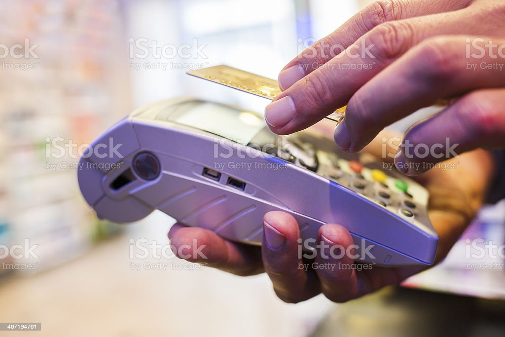 Close-up of Near Field Communication payment device and user stock photo