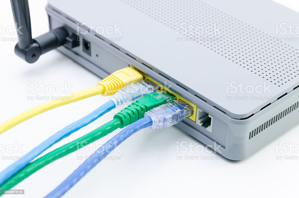 Closeup of network cables connected to wifi router on white stock photo