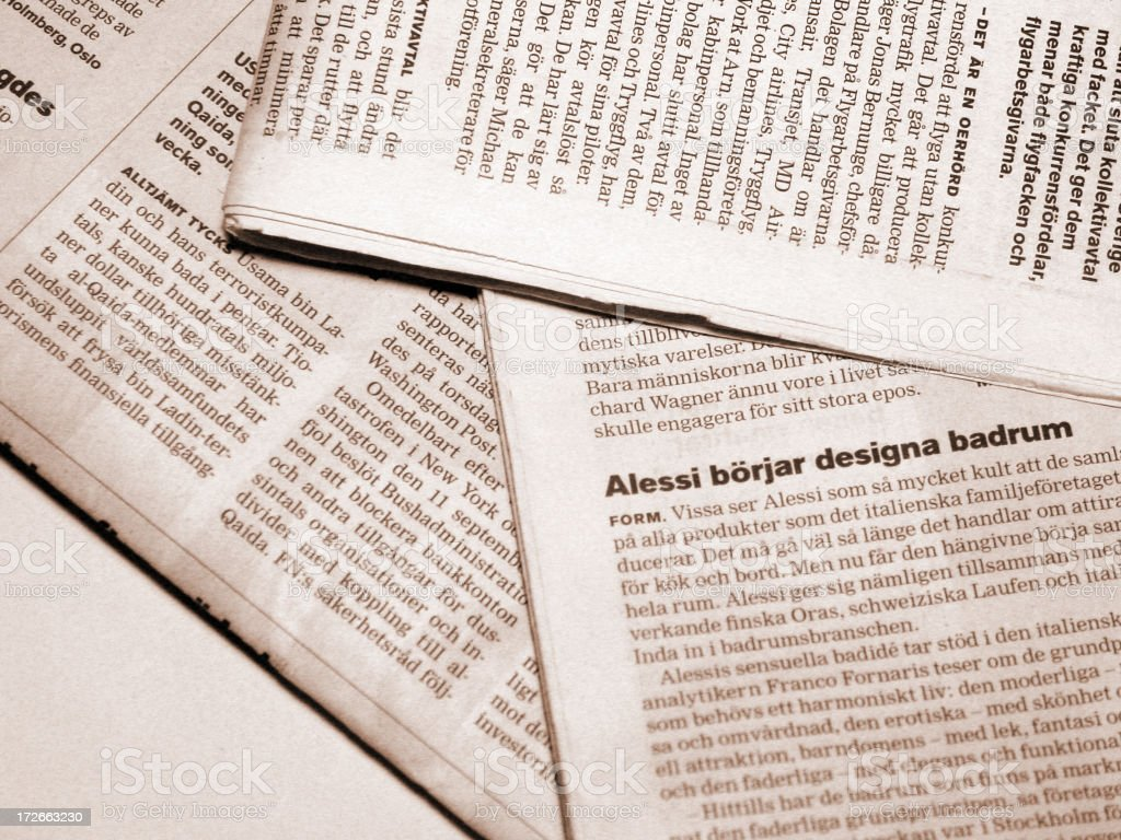 Close-up of newspaper in different languages stock photo