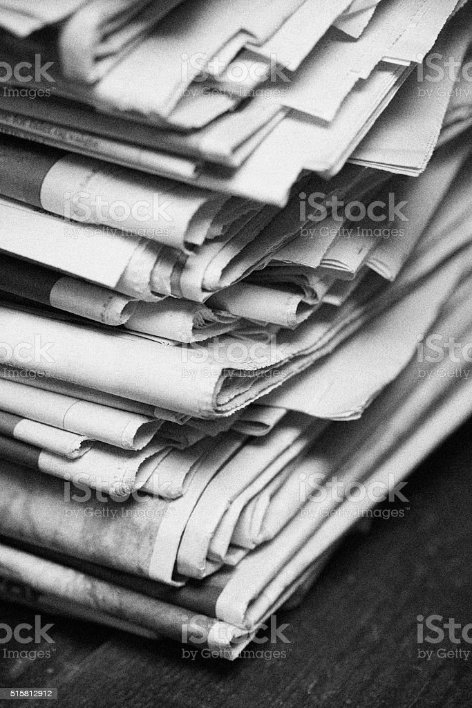 Close-up of newspaper stack stock photo