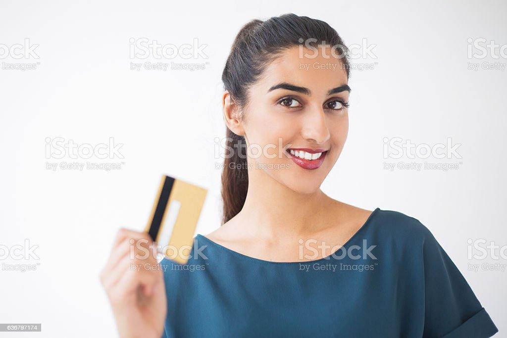 Closeup of Nice Indian Woman Showing Credit Card stock photo