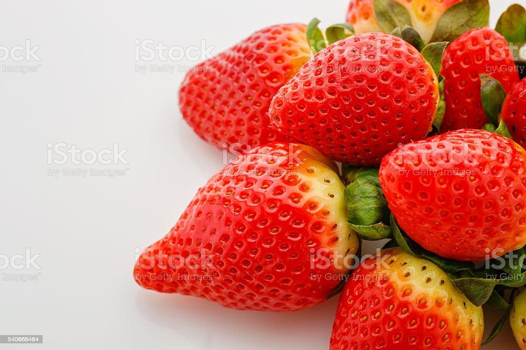 Closeup of not fully ripe strawberries stock photo