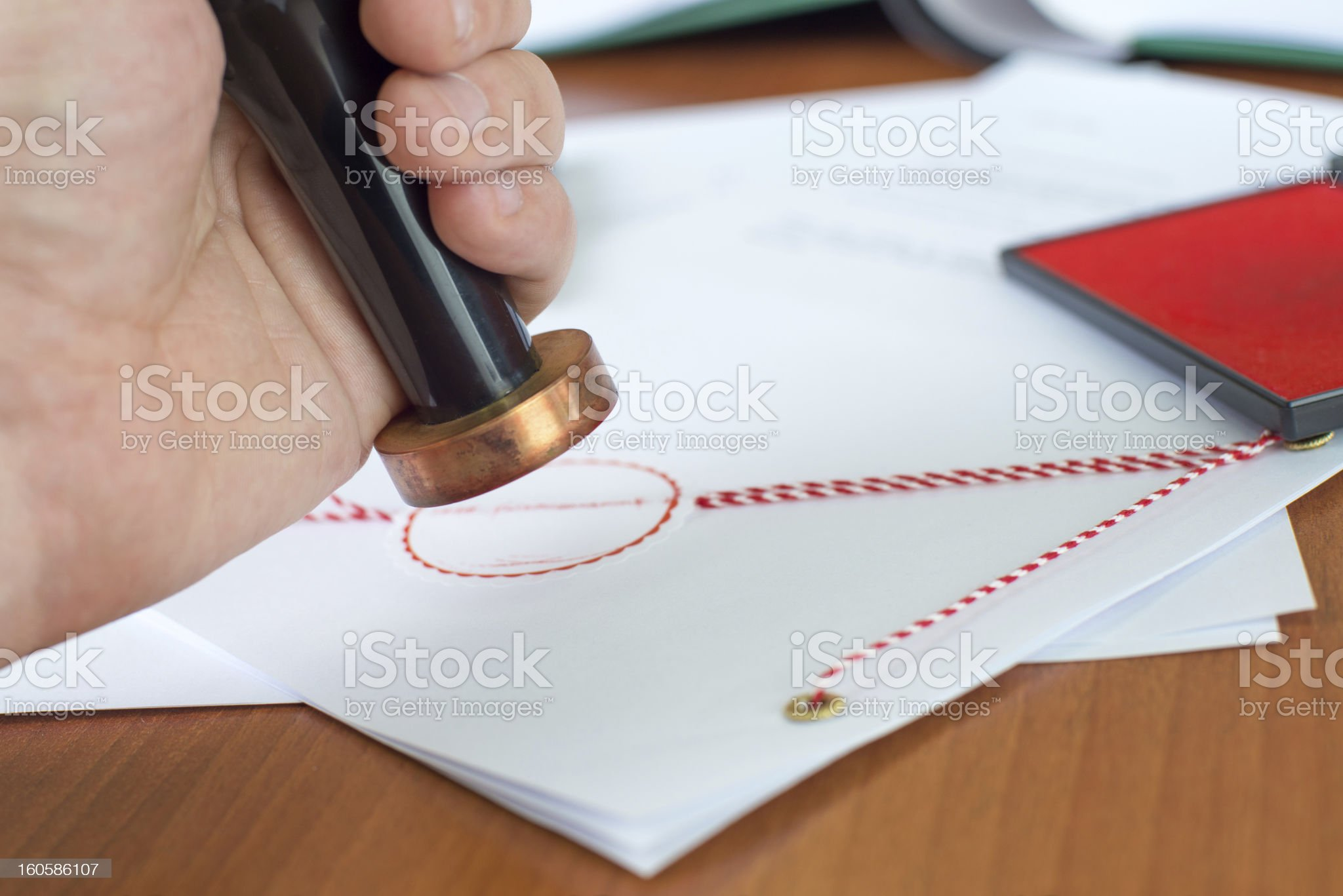 Close-up of notary stamping an important document royalty-free stock photo