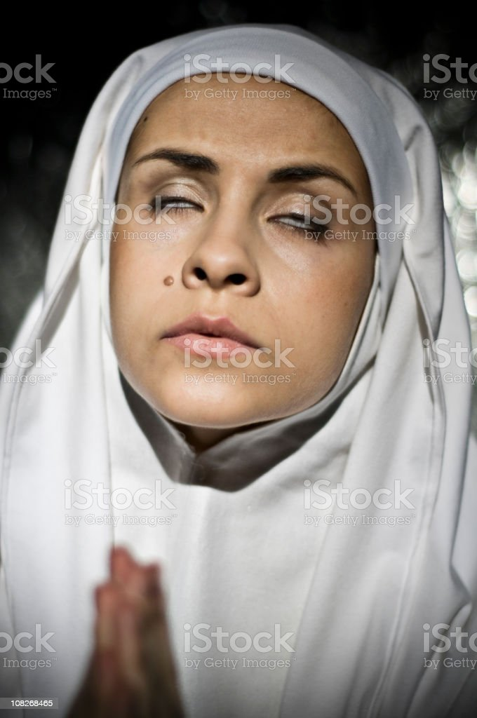 Close-up of Nun Praying and Closing Eyes royalty-free stock photo
