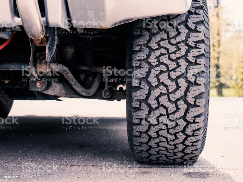 Close-up of offroad Mud-Terrain tire tread stock photo