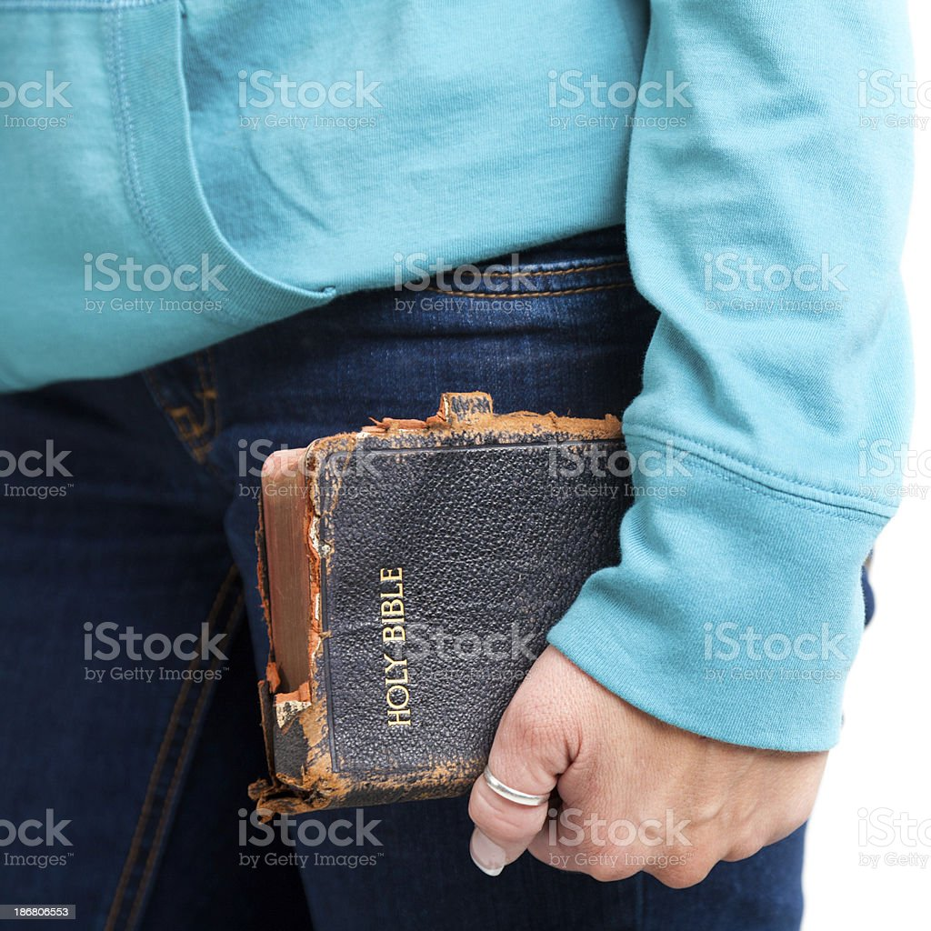 Closeup of old Bible  being held by adult woman royalty-free stock photo