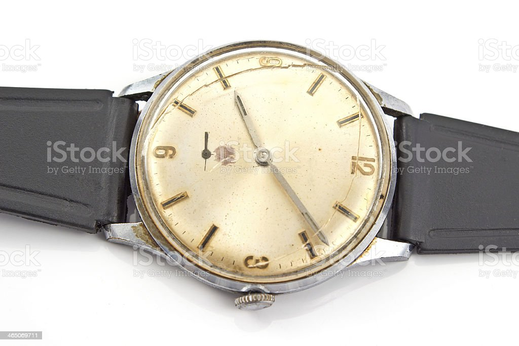 Closeup of old broken wristwatch isolated on white stock photo