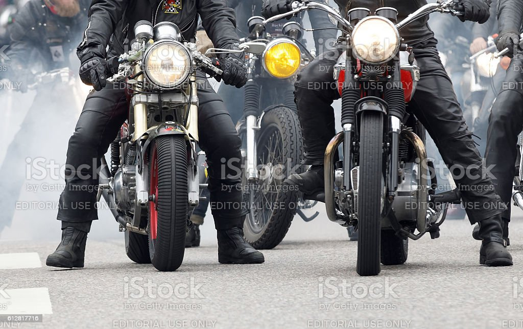Closeup of old fashioned motorcycles and bikers stock photo