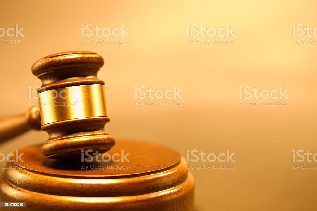Closeup of  old fashioned wooden gavel from the court stock photo