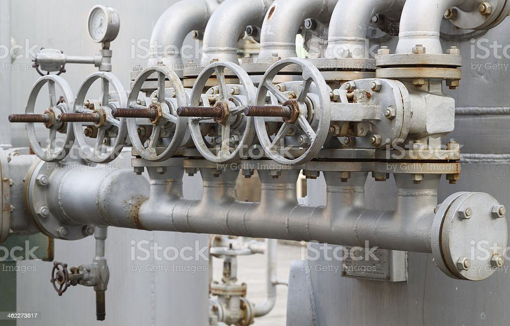 close-up of old gate valve on pipe connection royalty-free stock photo