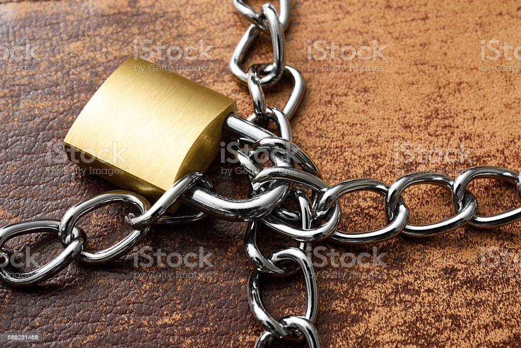 Close-up of old leather personal organizer with locked padlock stock photo