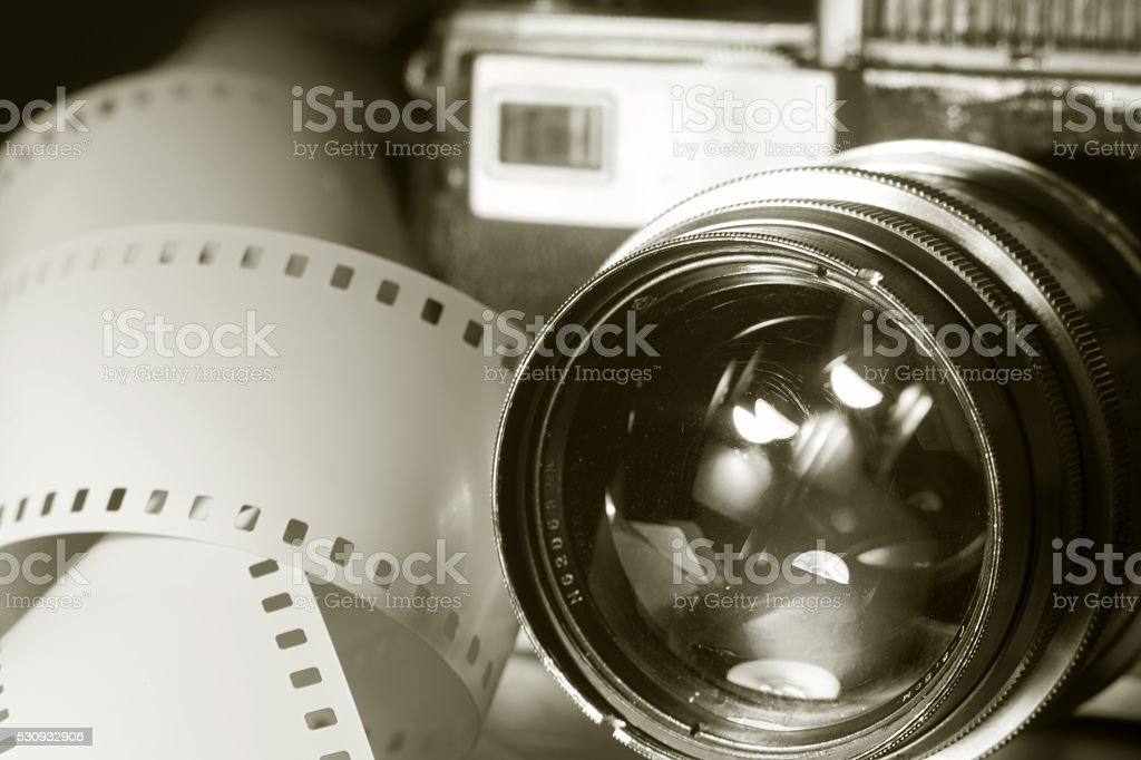 Close-up of old photo camera with metallic color stock photo