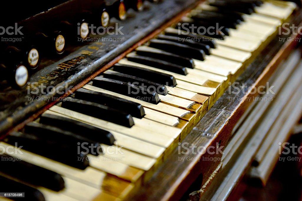 Closeup of old piano keyboard stock photo