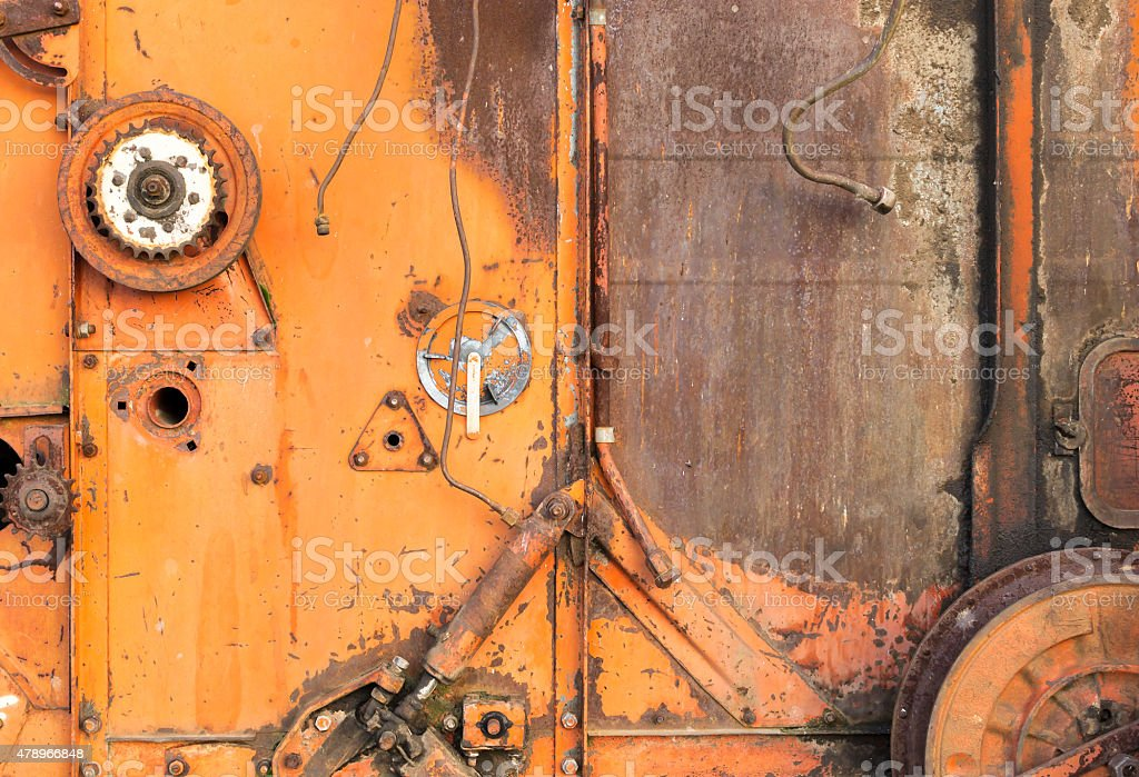Close-up of Old Red Harvester Cogs stock photo