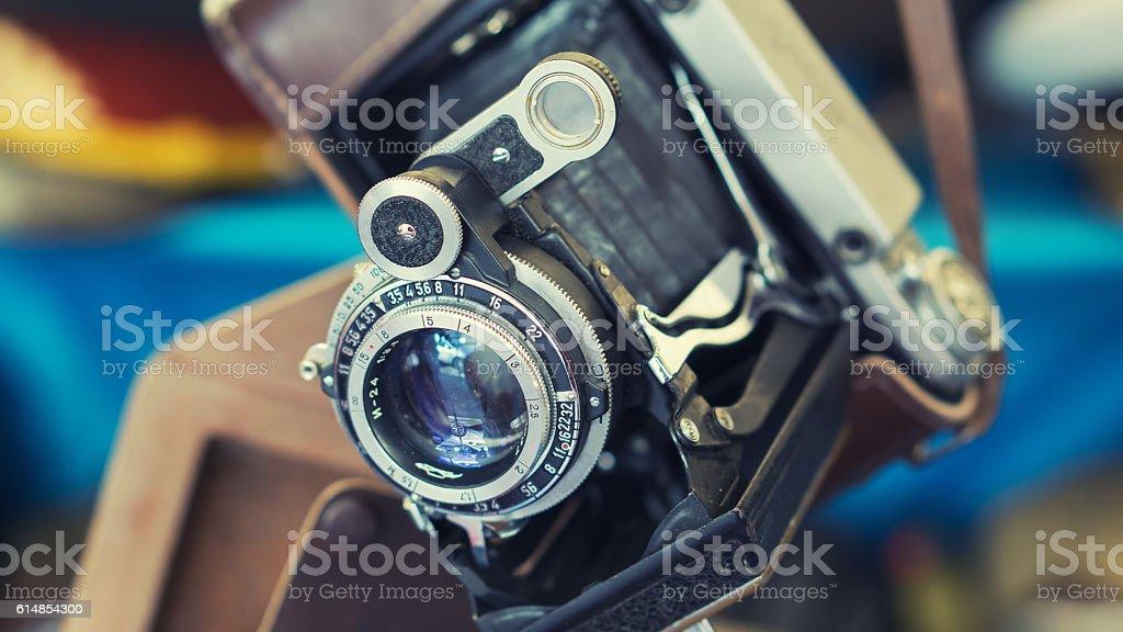 Closeup of old retro vintage film photo camera with lens stock photo