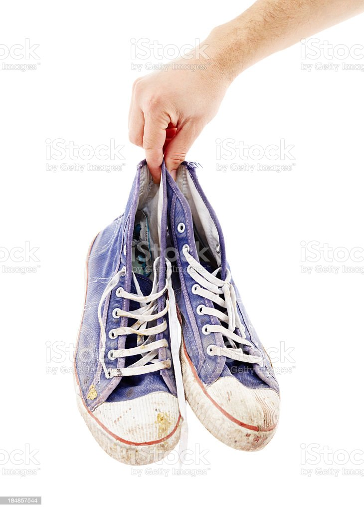 Close-up of old, stinky, dirty shoes stock photo