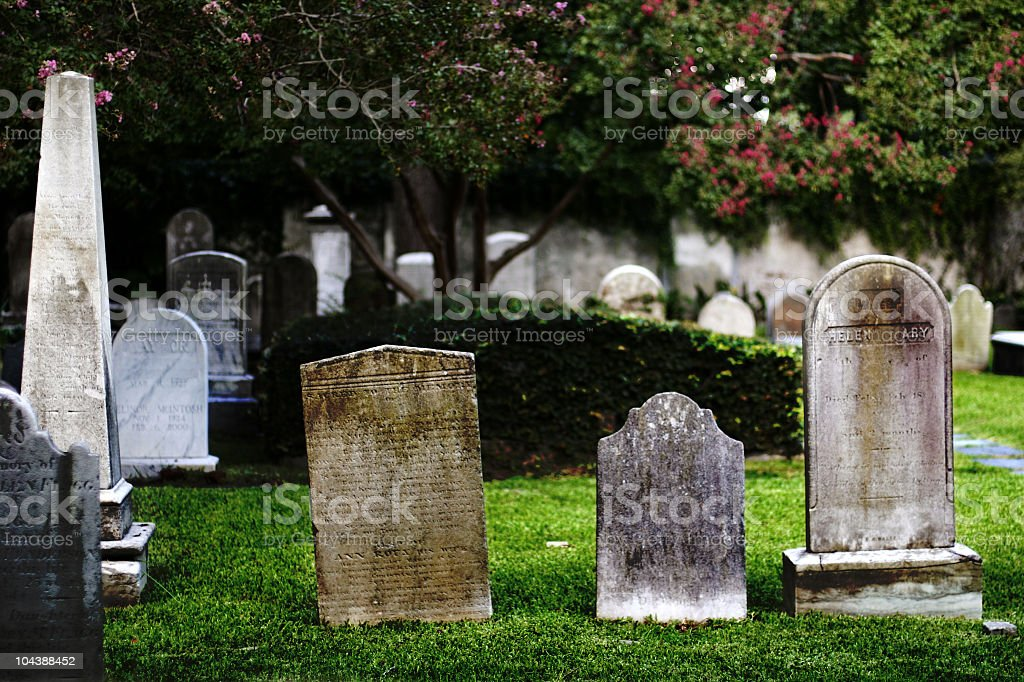 Close-up of old tombstones in a cemetery stock photo