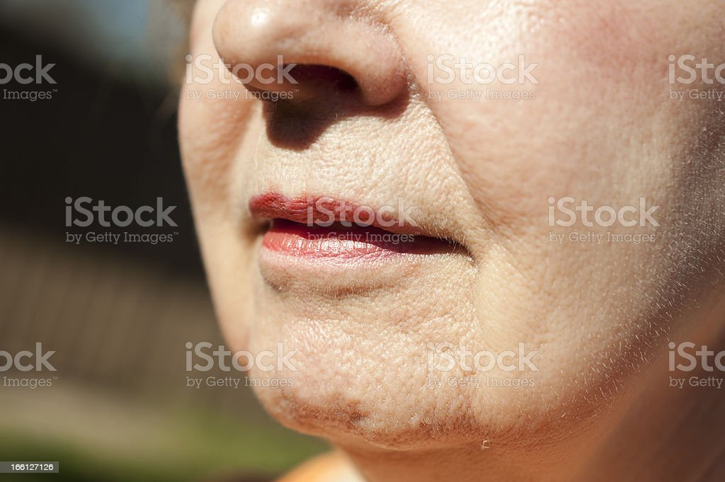 Close-up of old white woman nose and mouth royalty-free stock photo