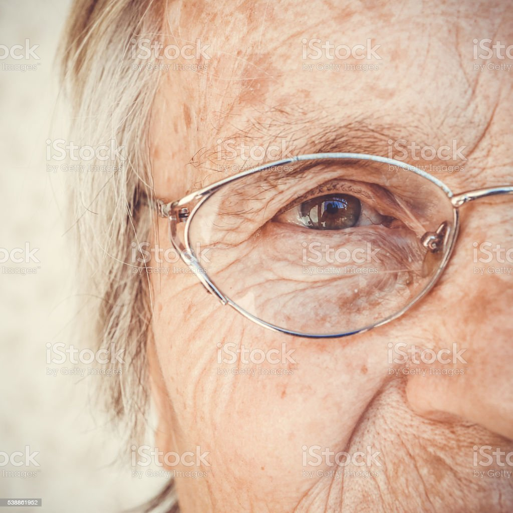 Close-up of old woman's eye stock photo