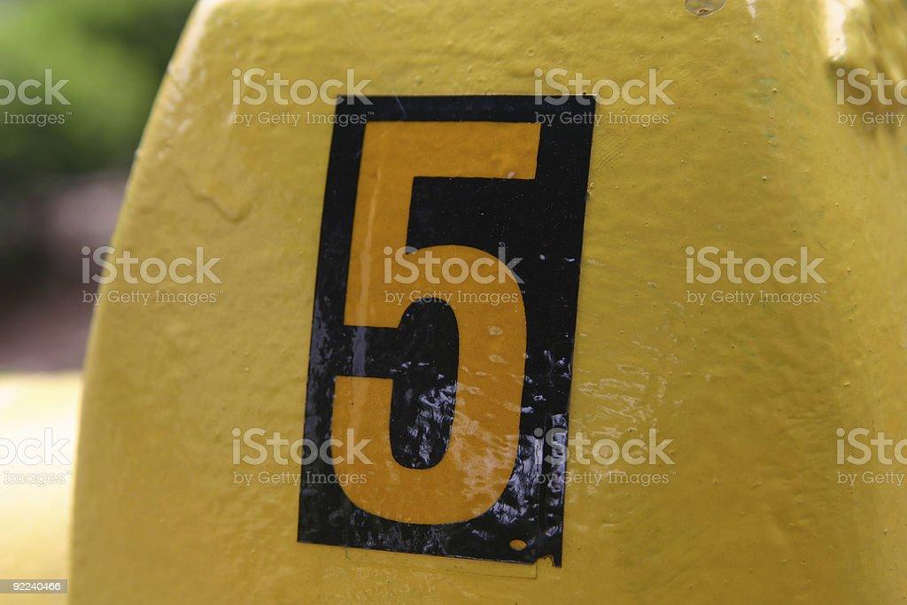 Closeup of #5 on firehydrant stock photo