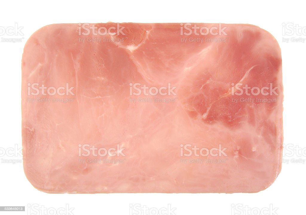 Closeup of one cooked and boiled ham sausage slice isolated stock photo