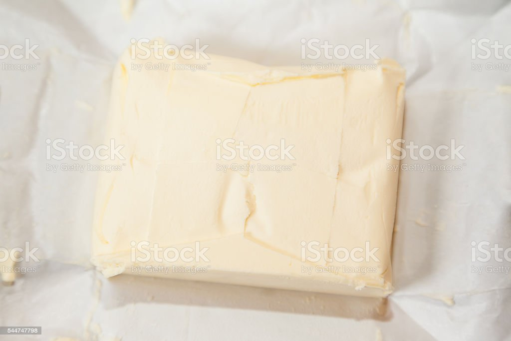 Closeup of open bricket of butter stock photo