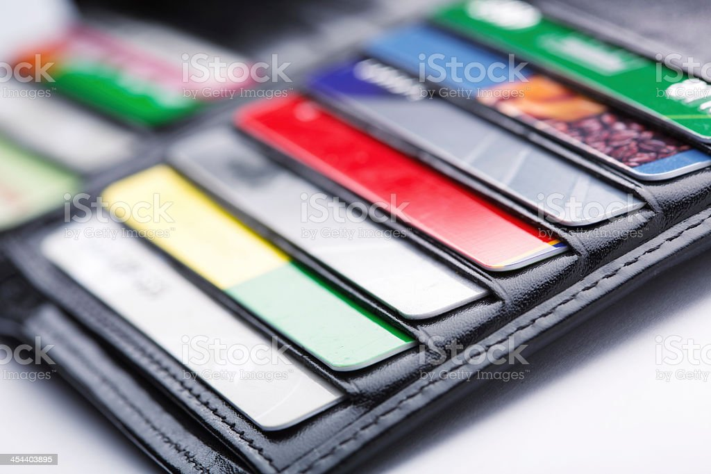 Close-up of open wallet with many credit cards in slots stock photo