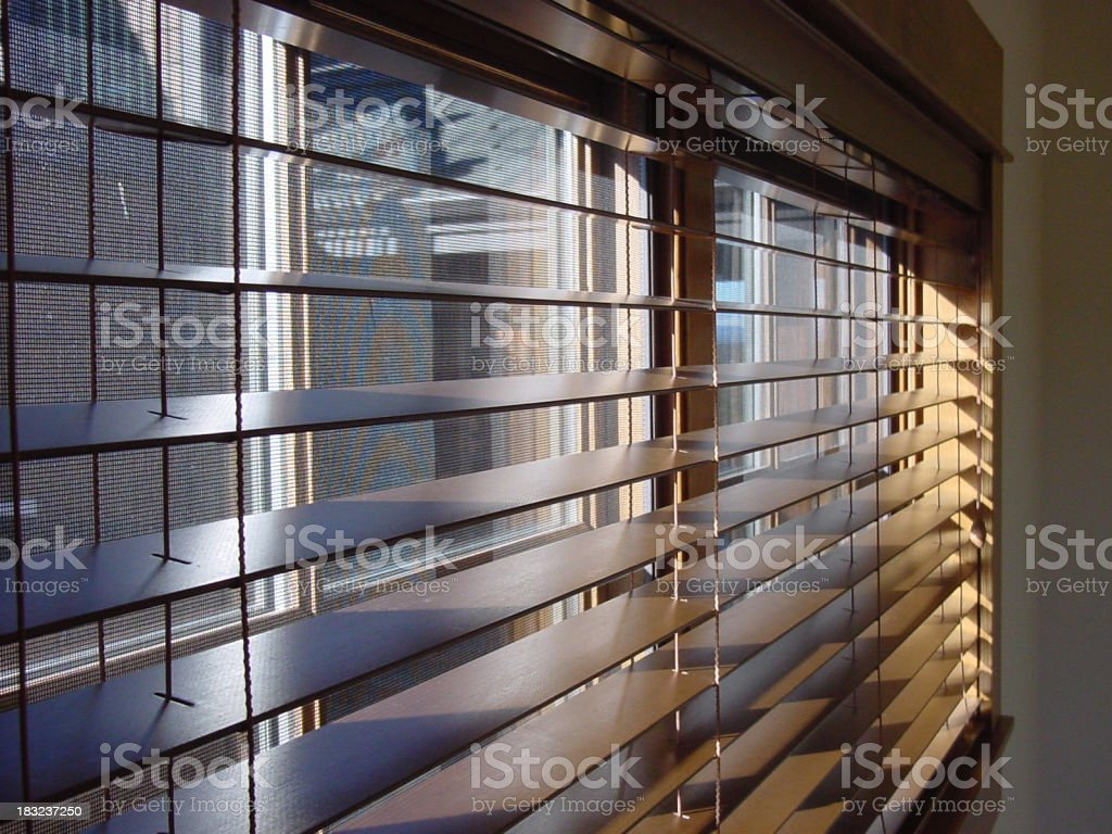 Close-up of open wooden window blinds stock photo