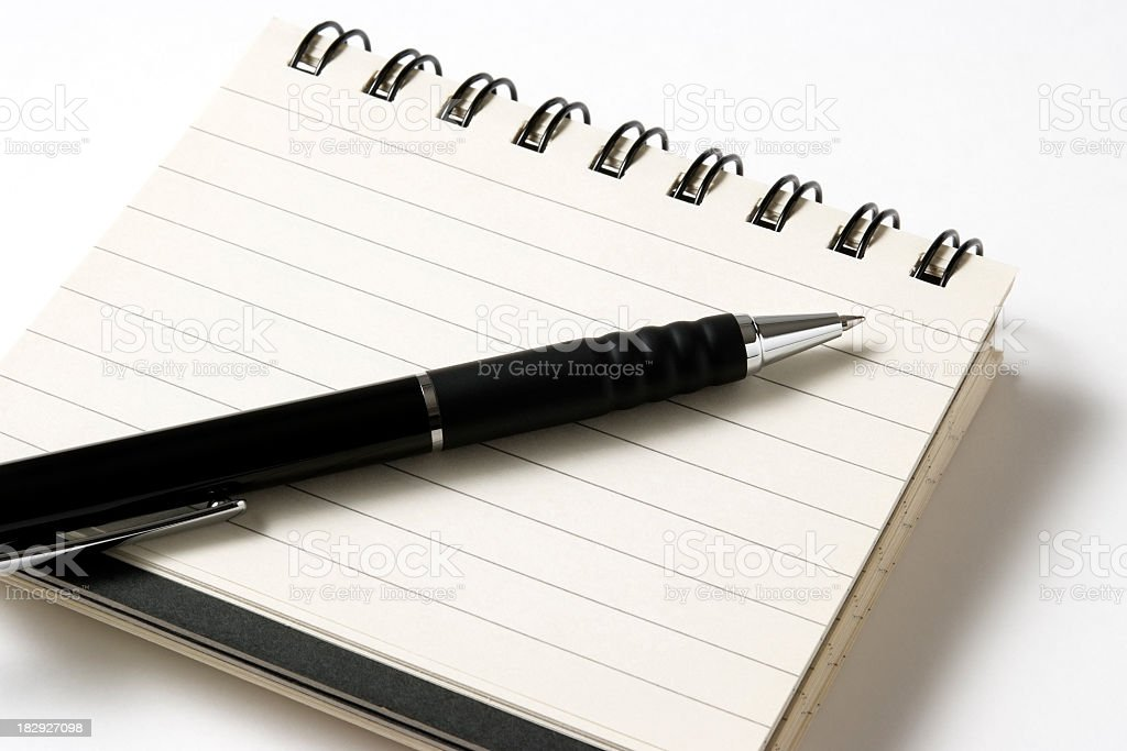 Close-up of opened blank spiral notebook with pen royalty-free stock photo