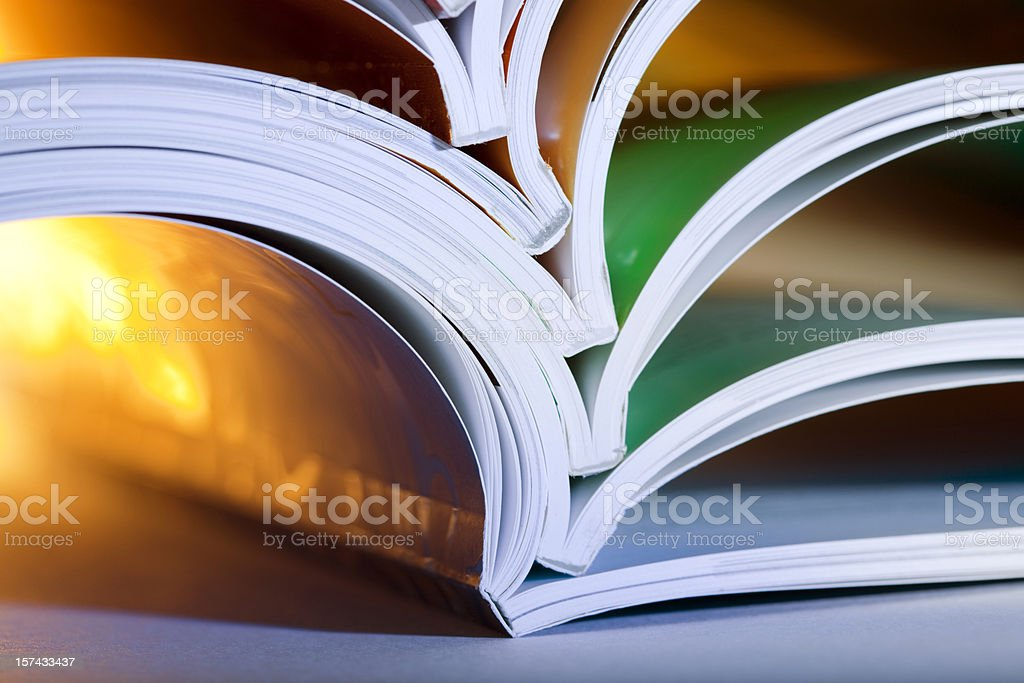 Close-up of opened magazines stock photo