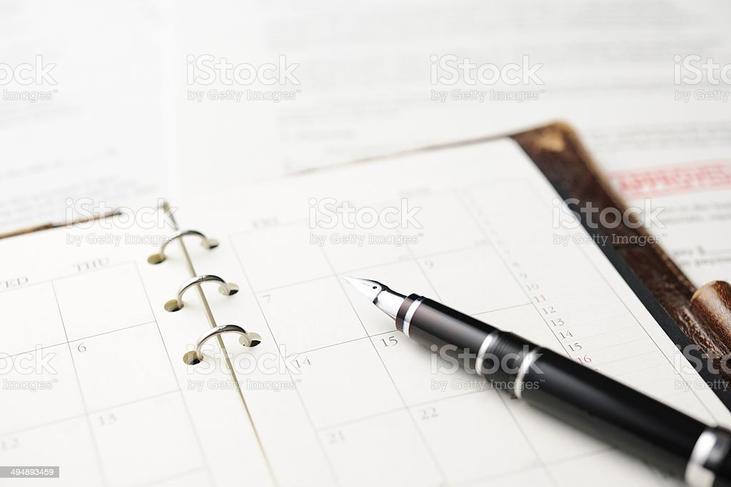 Close-up of opened personal organizer with Fountain Pen and document royalty-free stock photo