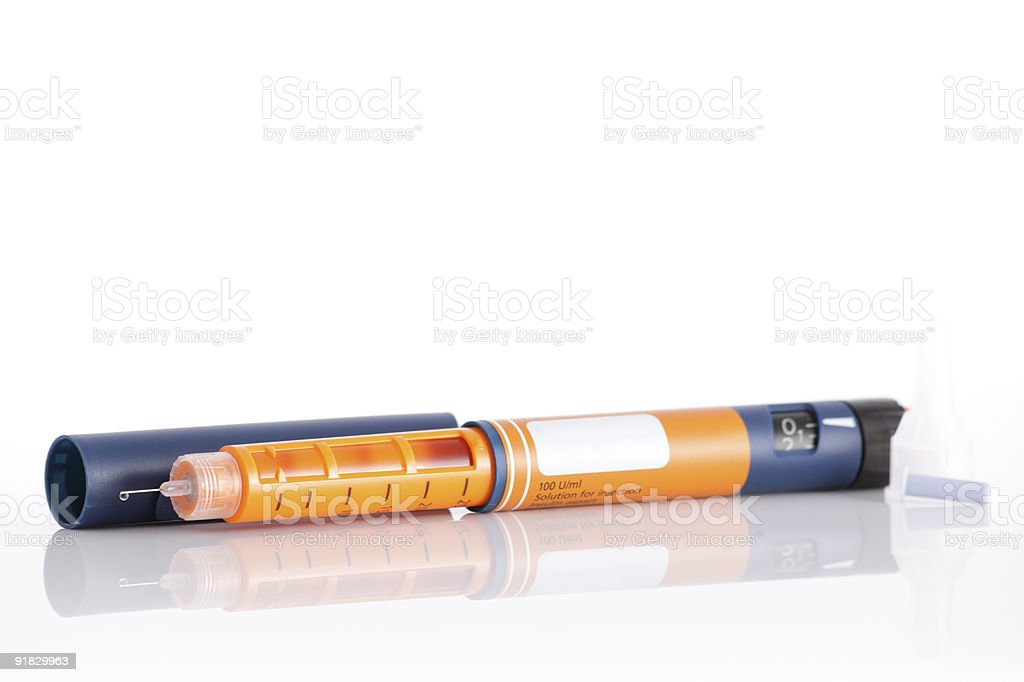 Close-up of orange and blue insulin pen stock photo