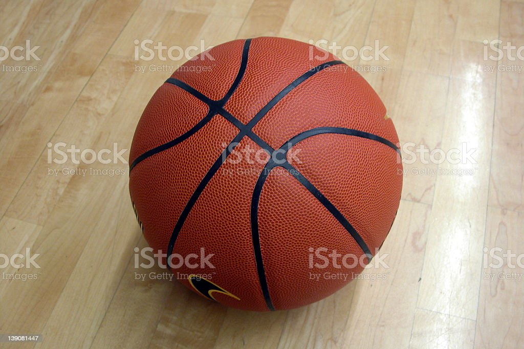 Close-up of orange basketball on wooden floor royalty-free stock photo