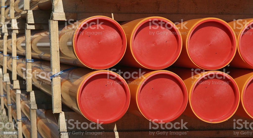 closeup of orange pvc tubes royalty-free stock photo