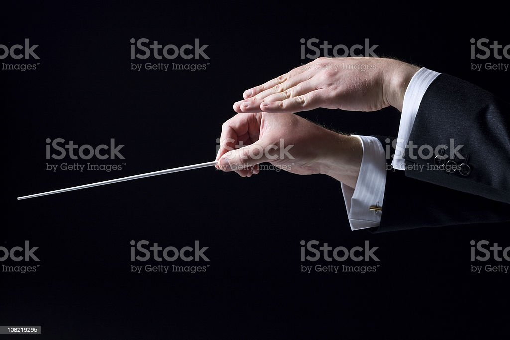Close-up of Orchestra Conductor's Hands, Isolated on Black stock photo