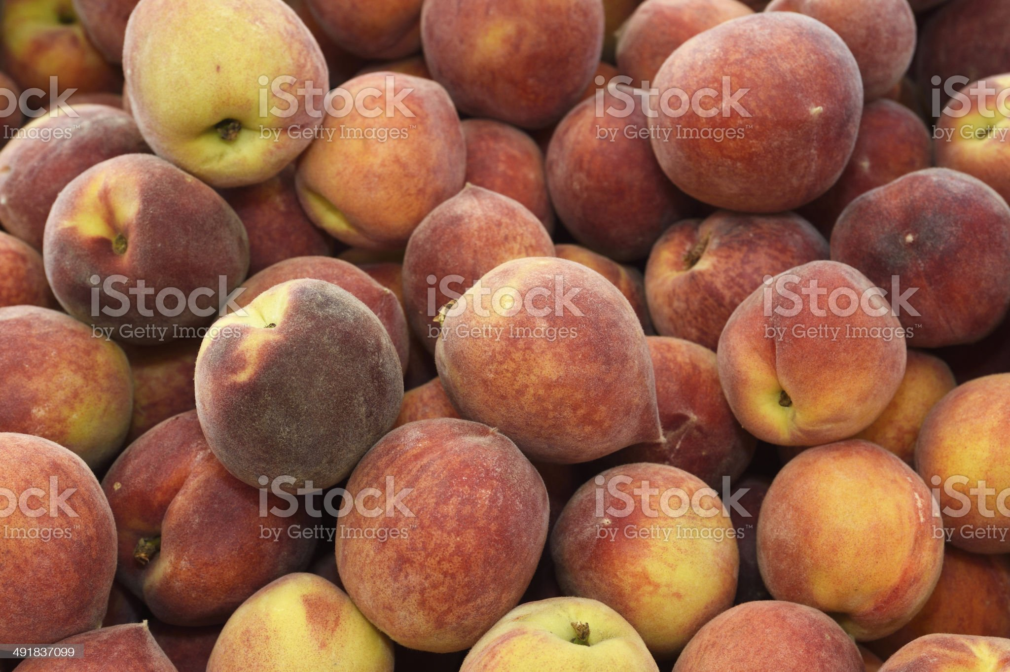 Close-up of Organic Peaches at Farmer's Market royalty-free stock photo