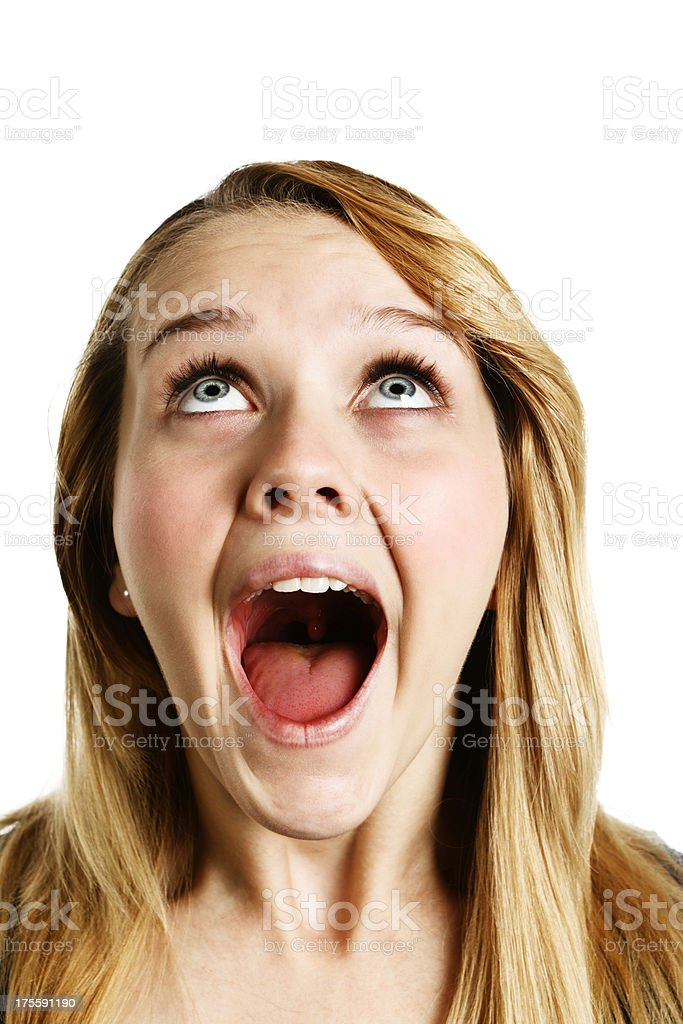 Close-up of overjoyed young blonde woman looking up stock photo