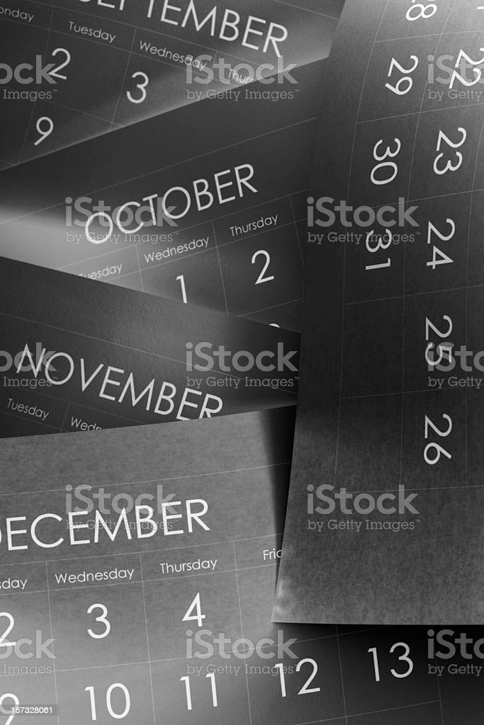 Close-up of pages of a calendar with the last four months royalty-free stock photo