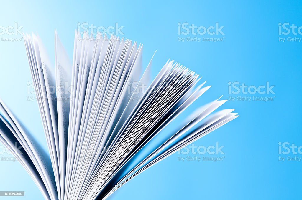 Close-up of pages of the book, thumb through the book royalty-free stock photo