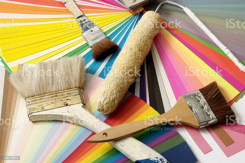 Close-up of paint brushes, roller,and color samples royalty-free stock photo