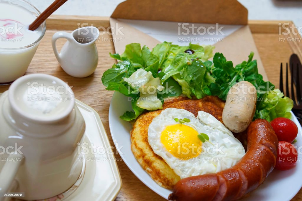 Close-Up Of Pancakes With Sausages Served On Table stock photo