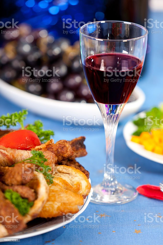 Close-up of party table with wine and meal royalty-free stock photo